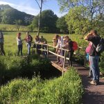 Members on a field trip looking at water vole reintroduction